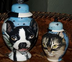 Custom ceramic and wood urns for your pets. Both extra large to the extra small! <3