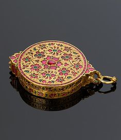 North India | Locket pendant; gold, inlaid with rubies and emeralds | Probably 17th century | The Al-Thani Collection