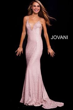 Floor length form fitting blush jersey prom dress with sheer sides features spaghetti straps bodice with embellished plunging neckline and open back. #Jovani #PROM2018