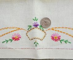 Sweet trio of linen tea towels with darling embroidered flowers circa 1925. Minty condition and wonderful hand work. All three at a Sale Price for a