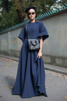 Chriselle Lim poses wearing Dior after the Dior show at the Musee Rodin during Paris Fashion Week Womenswear SS18 on September 26 2017 in Paris France