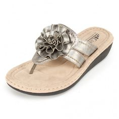 """<b>Featuring our revolutionary cushioned insole- you have to try it to believe it!</b> Thong style wedge sandal with single flower detail at instep. These eye catching flip flops feature a cushioned footbed and embellished flower detail. Add a touch of glamour to your poolside look.  <P><BR><B>Heel Height: 1.5""""</B>"""