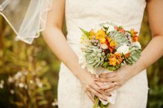 Beautiful fall bouquet featuring succulents and orange freesia! Designed by Alexan Events
