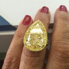 At @nasrinimani. Hellooooo to this beauty , 13.92 carats fancy yellow pear shape diamond ring #nasrinimani #rings