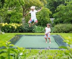 Built in trampoline!! Ive even seen the tutorial on better homes and gardens. Dig a hole, make a drainage trench for when it rains and insert trampoline. No more worrying about kids falling off and it looks nicer too