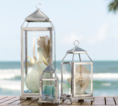 Organic Beach Reception: Silver lanterns with candles and beach glass