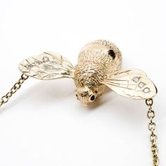 #Philippa #Holland collier bourdon #White #Bird http://www.vogue.fr/joaillerie/shopping/diaporama/bijoux-bestiaire-sensuel-animaux-serpent-aigle-panda/12349/image/738935#philippa-holland-collier-bourdon-white-bird