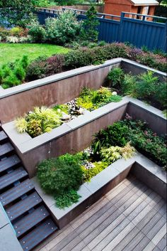 Gardening 279715826835917602 - multi level concrete retaining walls wooden deck contemporary landscape design Source by dcmetromodern Retaining Wall Design, Building A Retaining Wall, Concrete Retaining Walls, Concrete Walls, Wooden Retaining Wall, Sloped Backyard Landscaping, Sloped Garden, Garden Beds, Landscaping Ideas