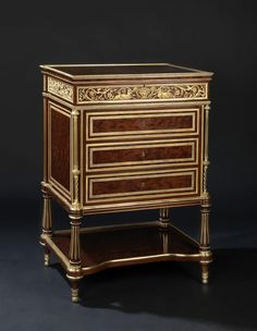 After Adam Weisweiler A Louis XVI Style Gilt-Bronze Mounted Dappled Mahogany Ladies Dressing Chest or Table en Chiffonière  French, Circa 1890.