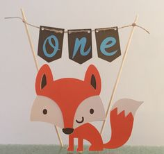 A personal favorite from my Etsy shop https://www.etsy.com/listing/465785477/woodland-fox-cake-topper-with-banner