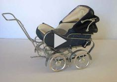 Brilliant ... the Robersons at work on a miniature pram ... incredible artisans