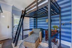 Eclectic Guest Bedroom with High ceiling, Hardwood floors, Built-in bookshelf, Carpet, Crown molding