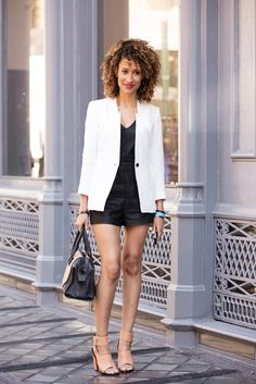 Blazer Outfits  Elaine Welteroth breaks up the line of a black jumpsuit with a trim, white, single-button blazer. #refinery29
