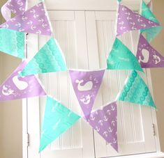 Hey, I found this really awesome Etsy listing at https://www.etsy.com/listing/192861499/nautical-mermaid-bunting-banner-fabric