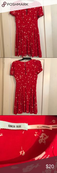 "Urban Outfitters Kimchi Blue Fit & Flare Dress Kimchi Blue, red fit & flare, red with white floral design,  keyhole at neckline, 3 button keyhole closure in back, hidden side zipper, 100% rayon.  Full circle flare at hem.  Measurements taken laying flat, 16"" armpit to armpit, 13.5"" waist.  EUC Kimchi Blue Dresses"