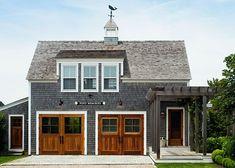 Greyed cedar shakes, white trim, wood doors