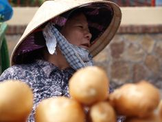 A vietnamese baguette seller in traditional hat, Chau Doc