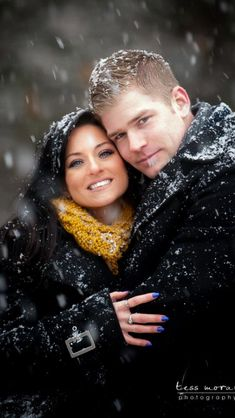 Engagement shoot on s snowy day! Her yellow scarf REALLY makes this photo look amazing.
