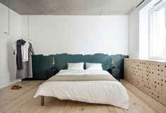 Check out this minimalist bedroom that beautifully combines pine and concrete. The space has an industrial feel to it but also has a natural warmth due the wood.