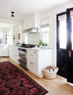 preposterousness: does this mean that i can get a persian rug for my kitchen too? this picture is very enabling.