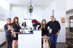 The Brufsky clan, including CAROLINE, 16, Jodi, GEORGIA, 13, SETH, and their dogs, Lula and Reggie, in the house's sleek kitchen. Pendant lights by JOHN POMP. A YOSHIMOTO NARA drawing hangs in the background.