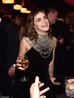 Having a laugh: She was seen drinking wine and having a laugh while she partied inside
