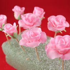 Fondant roses with a step by step picture tutorial.