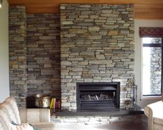 Schist fireplace with wood above. Would need room with right dimensions