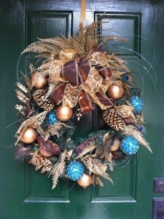 Elegant Turquoise & Bronze Peacock Feather Christmas Wreath. $95.00, via Etsy.