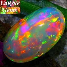 OPAL 9.47Ct ~PRISM MACKEREL EXPLODING FLAME Welo Opal~TOP HUGE!!   hard to get this huge size of the opal.Brilliant 5/5 of the multi color play which is A JOY TO HAVE IN YOUR COLLECTION OF GEMSTONES.