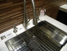 Franke's Peak sink was a hit @kbis2015! Shown with Franke's Tulip suite of faucets and waste disposer button.