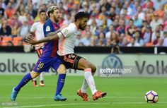 Barcelona's Argentinian forward Lionel Messi vies with Valencia's Argentinian defender Ezequiel Garay during the Spanish league football match...