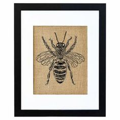 """Lend rustic appeal to your kitchen or dining room decor with this charming wall art, showcasing a honeybee motif in black.  Product: Burlap printConstruction Material: Engineered wood and burlapColor: Black frameFeatures: Handmade on the coast of MaineDimensions: 11"""" H x 14"""" WCleaning and Care: Avoid direct sunlight"""