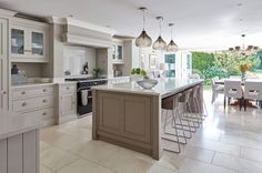 Painted in our timeless Willow and Tansy, this warm grey kitchen is as functiona… Open Plan Kitchen Dining Living, Open Plan Kitchen Diner, Living Room Kitchen, Kitchen Layout, Home Decor Kitchen, Kitchen Interior, New Kitchen, Home Kitchens, Kitchen Grey