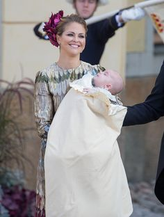 Princess Madeleine of Sweden carries her son Prince Nicolas for his Christening at Drottningholm Palace on October 11, 2015 in Stockholm, Sweden.