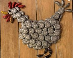 This handmade beer bottle cap rooster is 12 x 14 on a solid wood frame. Caps are 3 stacked to give it a bit more perspective. Its put together with glue to last a long time indoors and outdoors. Great gift for a kitchen, country decor, or vacation house. Bottle Cap Table, Beer Bottle Caps, Bottle Cap Art, Beer Caps, Glass Bottle, Diy Bottle Cap Crafts, Beer Cap Crafts, Bottle Cap Projects, Mason Jar Crafts