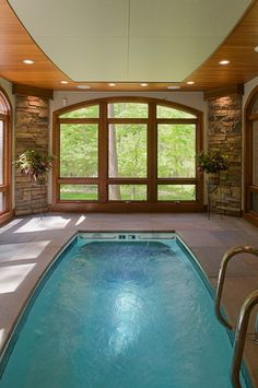 ceiling design indoor pool interior design interiors lighting michigan pool swimming windows walls spa stone water
