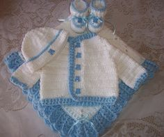 My mama spoiled me with this lovely outfit for our Little Man! I can't wait for his first photo shoot :)