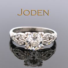 Designed with a diamond loop on either side of the center give this Art Deco diamond ring a unique look. This ring has such little wear it looks as though it has hardly been worn. Art Deco engagement rings blend perfectly with both vintage and modern jewelry making it perfect as a lifelong ring.