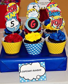 Super fun Kids Superhero Party Ideas with a newspaper headline backdrop, comic inspired banners & printables, mask bottle wraps, and superhero cake!