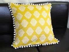Great yellow throw pillow to add a pop of color