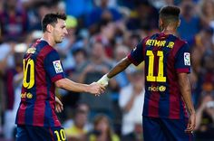 Lionel Messi of FC Barcelona shakes hands with Neymar of FC Barcelona after scoring his team's sixth goal during the La Liga match between FC Barcelona and Granada CF at Camp Nou on September 27, 2014 in Barcelona, Spain