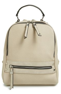 Clean, minimalist lines extend the urban sophistication of this faux-leather backpack embellished with polished silvertone hardware.