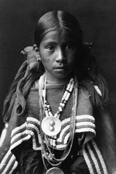 A young Native American photographed by #Edward_Curtis