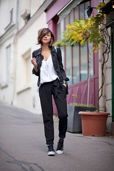 A chic and laid back look for spring: soft pants and a leather jacket.