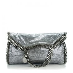 STELLA MCCARTNEY Metallic Glitter Small Falabella Fold Over Tote... ❤ liked on Polyvore featuring bags, handbags, tote bags, fold over tote, white tote, foldable tote, handbags totes and silver metallic handbags