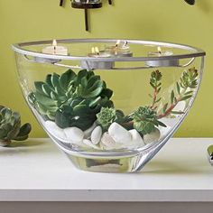 I love this natural looking #centerpiece!! rocks, succulents, candles, glass, modern