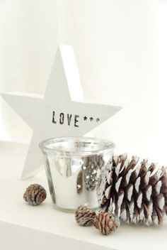 Beautiful Christmas candle vignette with mercury glass-- pine cones add a special touch!