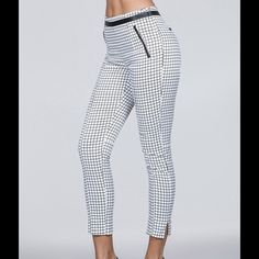 Leather-Trim High-Waisted Grid Print Ankle Pants Item Description This pants feature: Grid print Hits at the ankle Side slit Leather-trim detail at the waist, side, and back Side zipper closure 65% cotton/30%% polyester/5% spandex  Please Note: Review size chart for an accurate fit of the style/brand. less Private Label Pants Ankle & Cropped