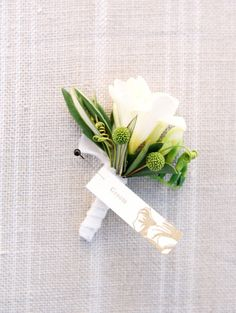Classically beautiful boutonniere: http://www.stylemepretty.com/2015/02/03/oregon-valley-outdoor-garden-wedding/   Photography: Clary Pfeiffer - http://www.claryphoto.com/